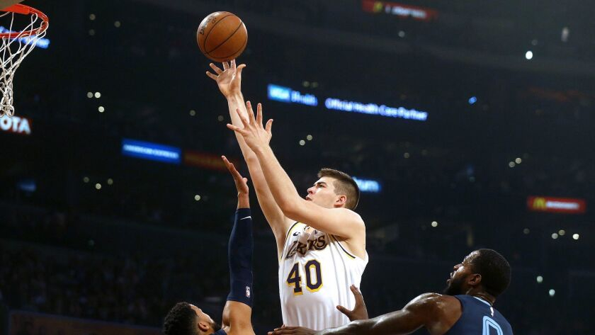 Lakers center Ivica Zubac (40) shoots over Memphis Grizzlies guard Garrett Temple (17) and Memphis Grizzlies forward JaMychal Green (0) in the first half at the Staples Center on Dec. 23, 2018.