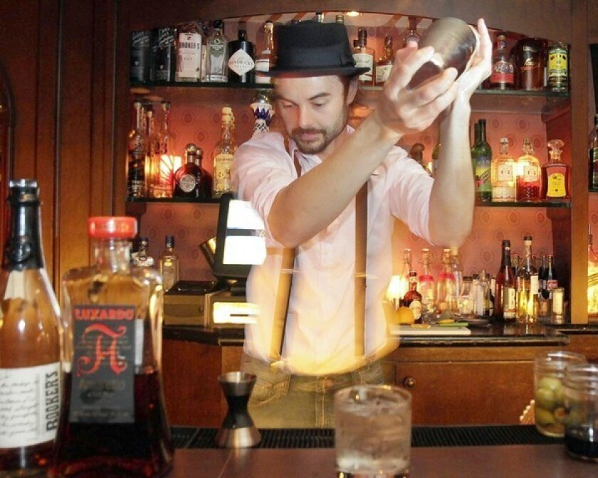 Brandon Reynolds Ristaino mixes up a drink behind the bar at Del Monte Speakeasy.