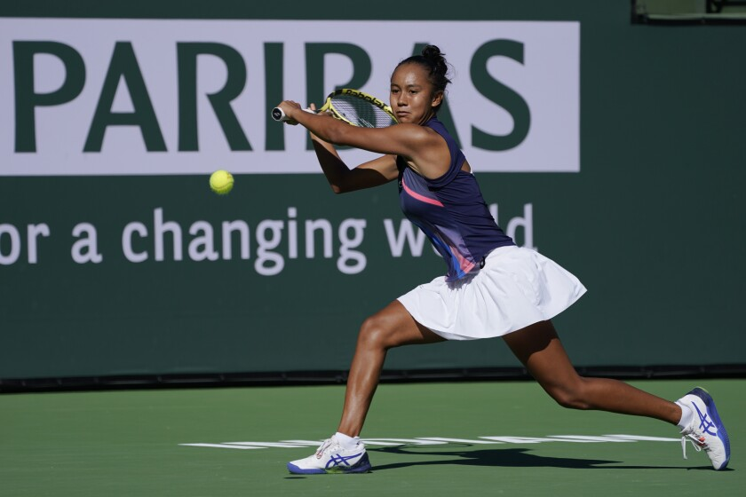 Leylah Fernandez returns a shot to Shelby Rogers at the BNP Paribas Open.