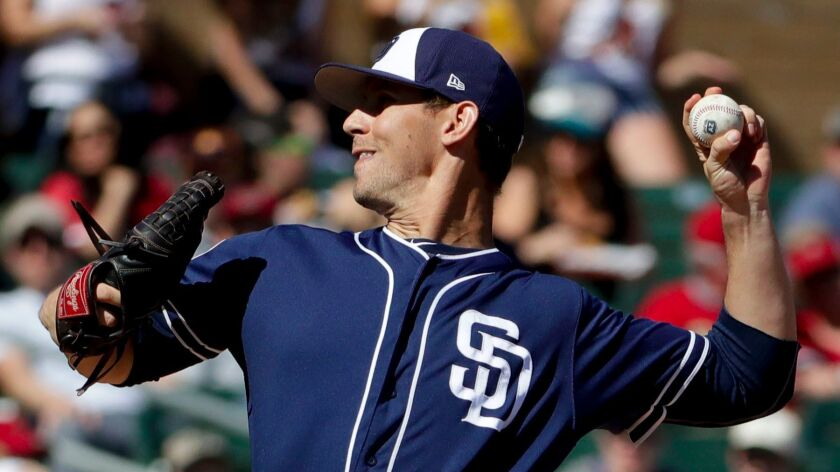 San Diego Padres starting pitcher Christian Friedrich throws against the Arizona Diamondbacks during the first inning of a spring baseball game in Scottsdale, Ariz., Thursday, March 2, 2017. (Chris Carlson / AP)