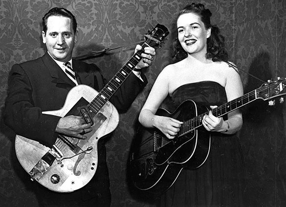 Les Paul and his wife, Mary Ford, perform on guitar. Paul, 94, the guitarist and inventor who changed the course of music with the electric guitar and multitrack recording, has died.