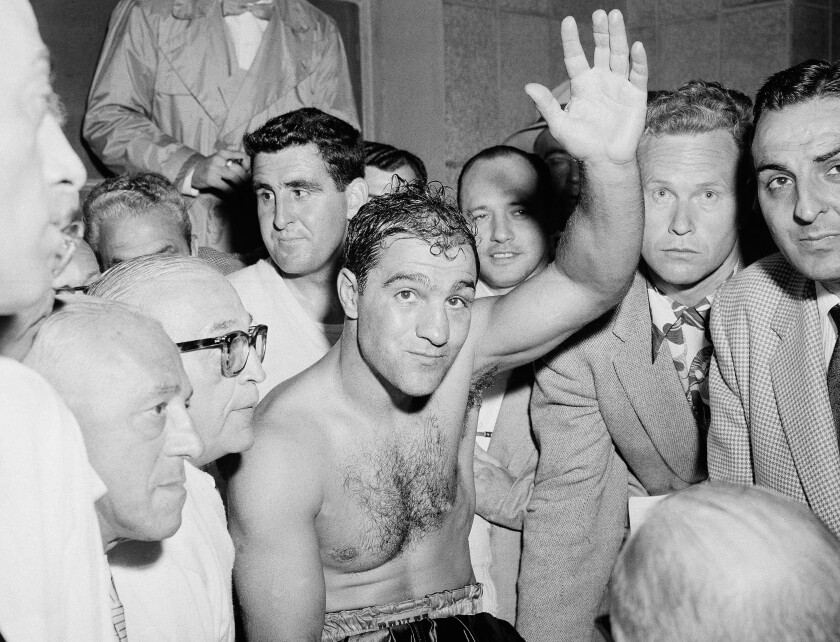 Rocky Marciano celebrates after defeating Ezzard Charles in a heavyweight title bout at Yankee Stadium in June 1954.