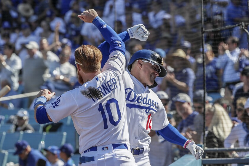 LOS ANGELES, CA, THURSDAY, MARCH 28, 2019 - Kiké Hernandez celebrates with Dodgers teammate Justin T