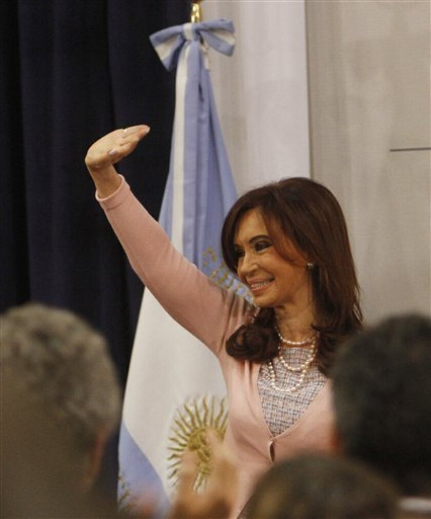 Argentina's President Cristina Fernandez waves to supporters and members of the gay community after signing the same sex marriage bill at the Latin America Patriots room of the government house in Buenos Aires, Wednesday, July 21, 2010. (AP Photo/ Eduardo Di Baia)
