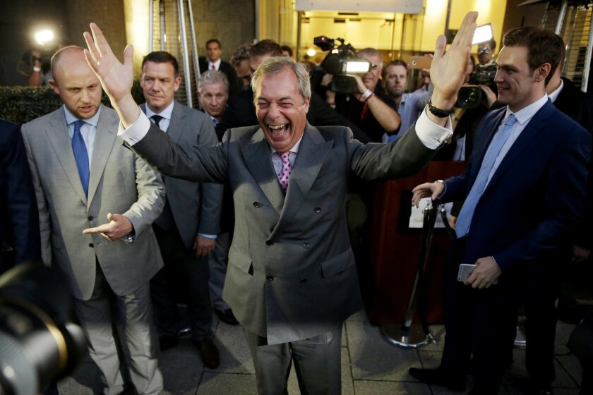 """Nigel Farage, the leader of the UK Independence Party, celebrates and poses for photographers as he leaves a """"Leave.EU"""" organization party for the British European Union membership referendum in London, Friday, June 24, 2016. On Thursday, Britain voted in a national referendum on whether to stay in"""