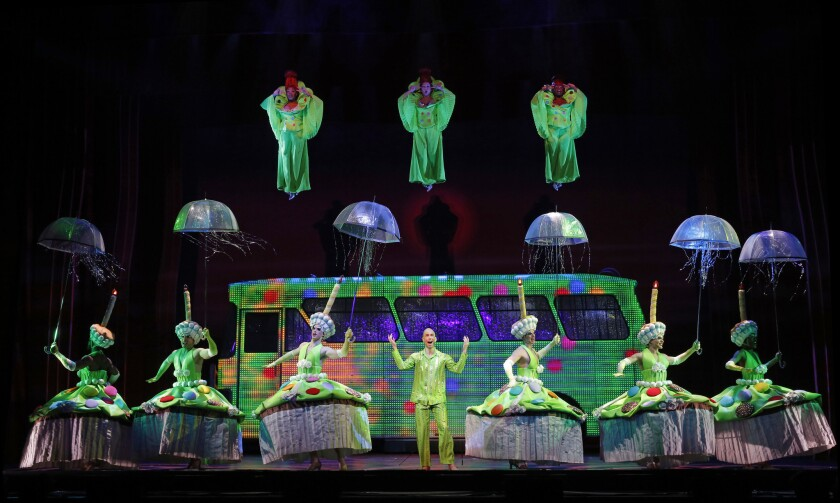 """Tick (Wade McCollum) performs """"MacArthur Park"""" as a cake-drunk fantasia with dangling divas and the ensemble of """"Priscilla Queen of the Desert: The Musical,"""" now at the Pantages Theatre."""