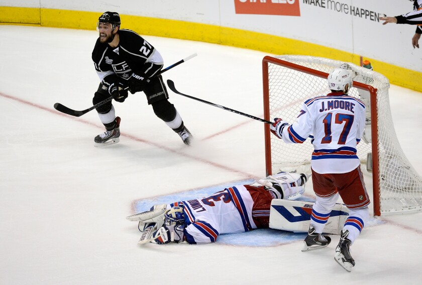 Alec Martinez celebrates after scoring against New York Rangers goalie Henrik Lundqvist in double overtime to clinch the 2014 Stanley Cup title.