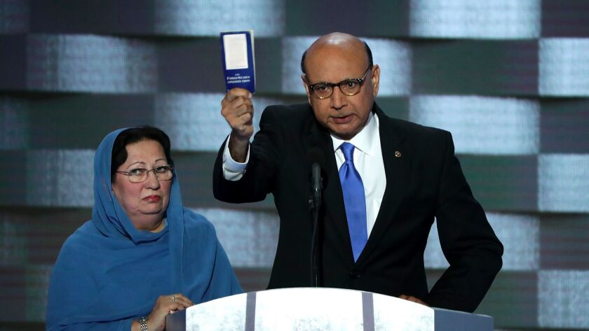 Khizr Khan holds a pocket U.S. Constitution at the Democratic National Convention in July.