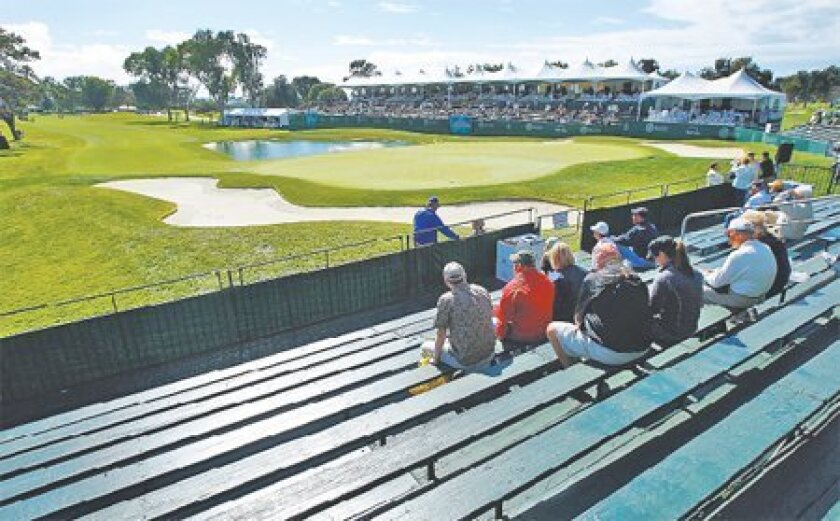 Spectators had room to stretch on the 18th hole at Torrey Pines on Feb. 5, 2009. Blame the weather, the economy, the workweek, but Tiger  Woods' absence left a void.  (K.C. Alfred / Union-Tribune)