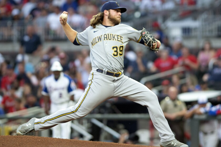 Milwaukee Brewers starting pitcher Corbin Burnes throws during the first inning of a baseball game against the Atlanta Braves, Friday, July 30, 2021, in Atlanta. (AP Photo/Hakim Wright Sr.)