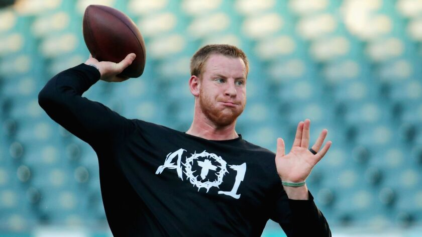 Carson Wentz throws before the Eagles' season opener.