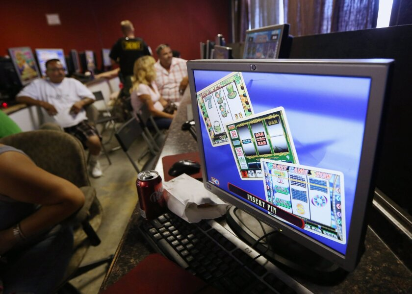 Sweepstakes' games at Internet cafes are illegal, state high court