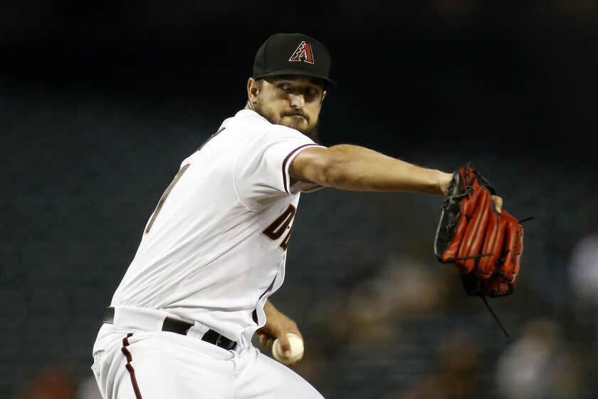 Arizona Diamondbacks pitcher Caleb Smith delivers against the Pittsburgh Pirates during the first inning of a baseball game Monday, July 19, 2021, in Phoenix. (AP Photo/Darryl Webb)