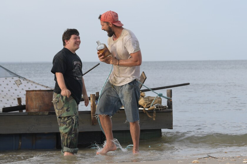 "Zack Gottsagen and Shia LaBeouf in a scene from ""The Peanut Butter Falcon."""