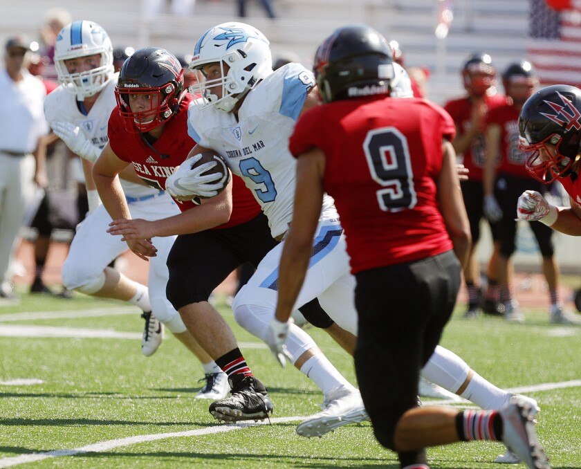 Corona del Mar's Carter Duss looks for running room against Palos Verdes during a nonleague game Sept. 6.