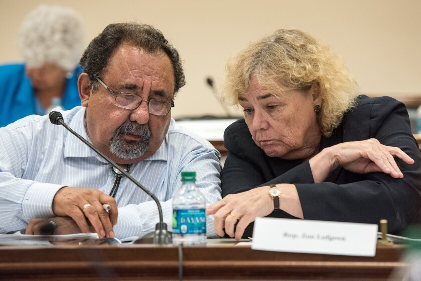 Reps. Raul Grijalva (D-Ariz.) and Zoe Lofgren (D-San Jose) confer at a forum on the detention of immigrant families Tuesday on Capitol Hill. Leading Democrats in Congress have called for an end to family detention.