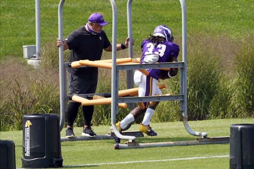 Minnesota Vikings running back Dalvin Cook (33) goes through a drill during the NFL football team's training camp Monday Aug. 24, 2020, in Eagan, Minn. (AP Photo/Jim Mone)