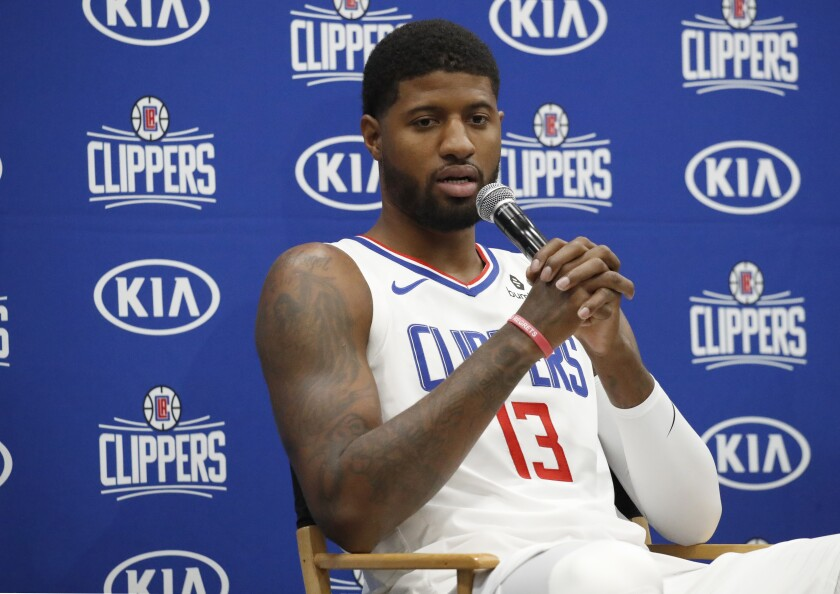 Paul George speaks during Clippers media day on Sunday in Playa Vista.