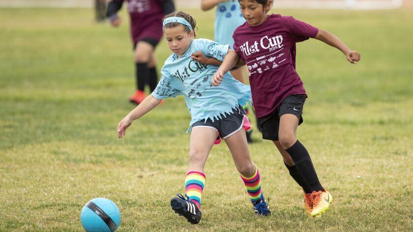 Costa Mesa Sonora's Vanessa Zarate battle for a ball against Costa Mesa St. Joachim Catholic School'