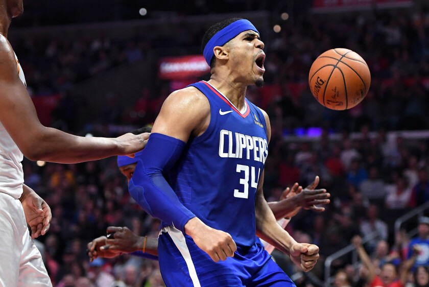 Clippers' Tobias Harris celebrates his dunk against Indiana on April 1.