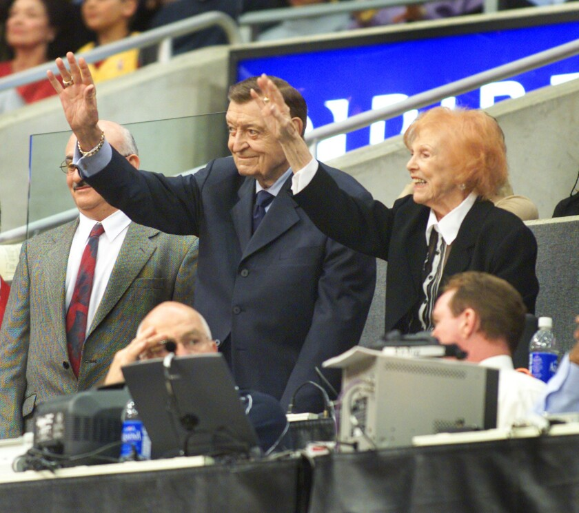 Lakers announcer Chick Hearn and his wife, Marge, at Staples Center in 2002.