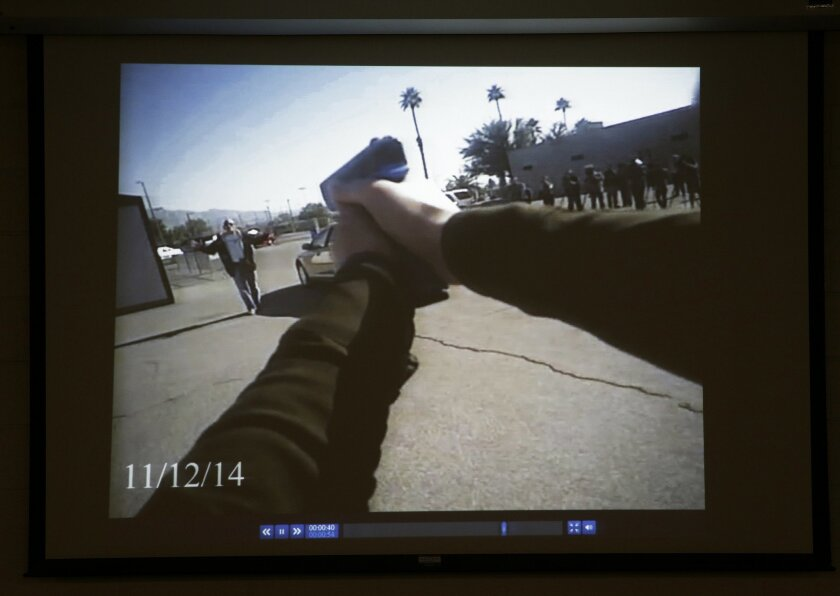 Footage from a Las Vegas police department body camera demonstration is projected on a screen Wednesday, Nov. 12, 2014, in Las Vegas. The camera is the same type now being used by about 200 street officers in Las Vegas. (AP Photo/John Locher)
