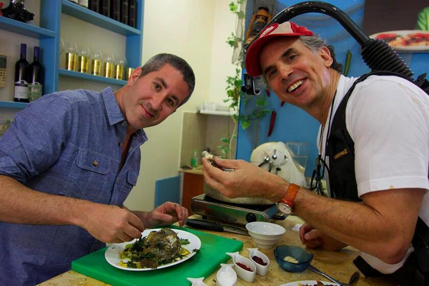 Chef Mike Solomonov (left) visits more than 100 locations in Israel — talking to chefs, home cooks, winemakers, cheesemakers and farmers — for the documentary film, 'In Search of Israeli Cuisine,' directed by Roger Sherman (right).