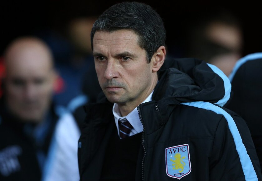 """FILE - In this file photo dated Saturday, Jan. 2, 2016, Aston Villa's manager Remi Garde waits for the start of the English Premier League soccer match between Sunderland and Aston Villa at the Stadium of Light, Sunderland, England. Garde has left the bottom-placed Premier League club left by """"mutual consent,"""" after nearly five months in charge at the club. (AP Photo/Scott Heppell, FILE)"""
