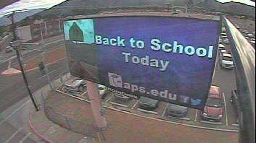 Albuquerque Public Schools make $225,000 a year from eight commercial billboards, including this one. L.A. Unified is discussing allowing them as well.