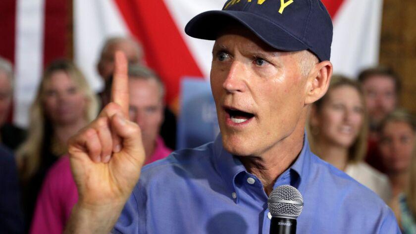 Florida Gov. Rick Scott announces his bid to run for the U.S. Senate at a news conference Monday in Orlando, Fla.