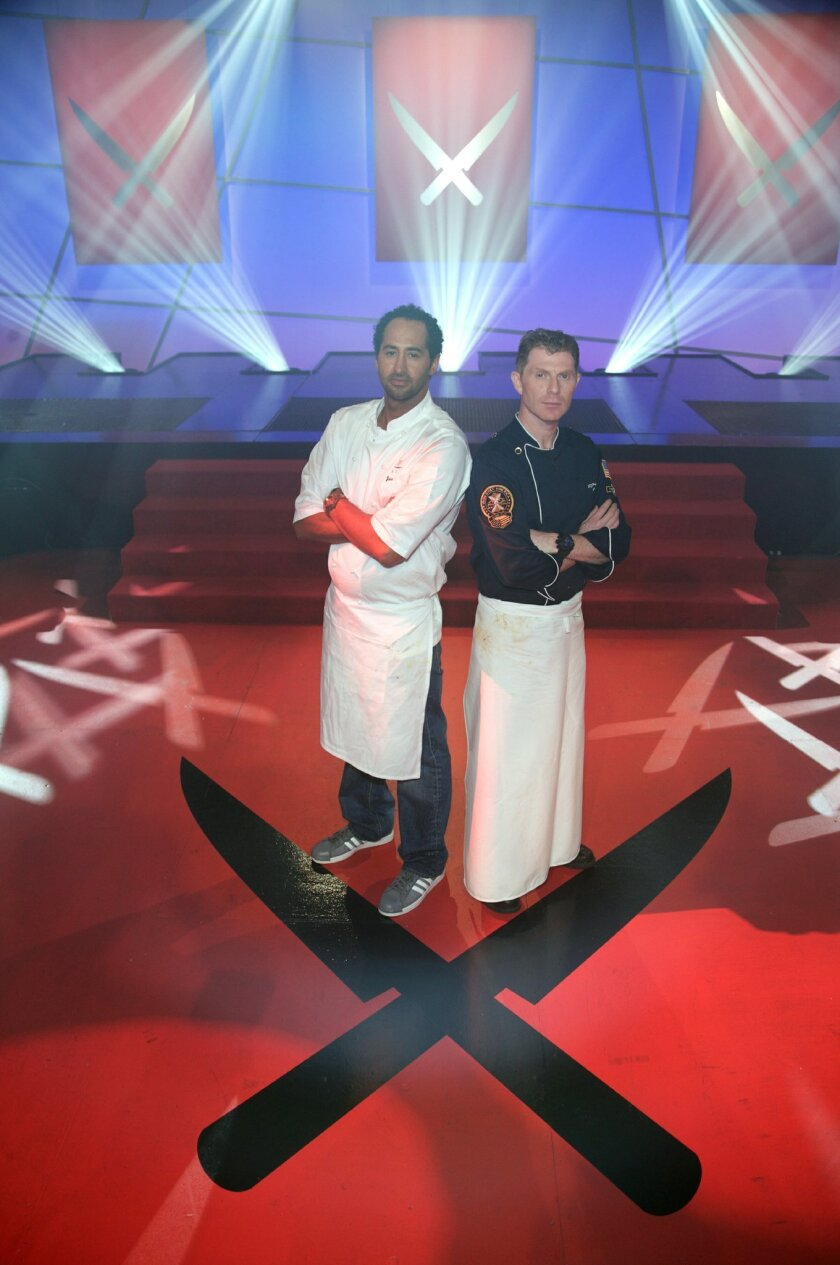 "Jason Knibb (left), executive chef at Nine-Ten Restaurant in La Jolla takes on Bobby Flay in Sunday's episode of ""Iron Chef America."" Food Network"