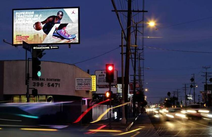Digital billboards such as this one in Venice are the focus of a ruling that will pull the plug on dozens of signs.