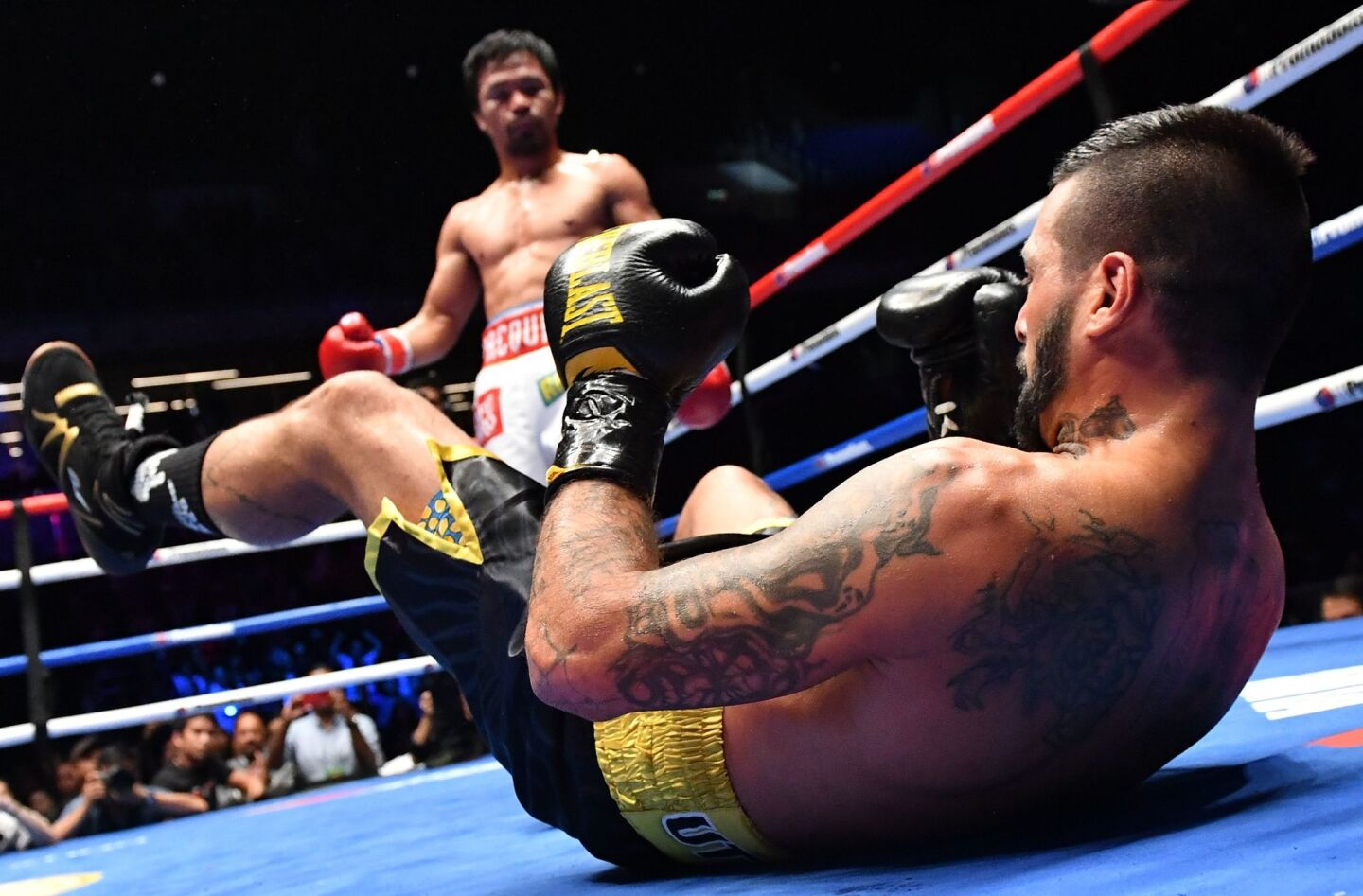 TOPSHOT - Argentina's Lucas Matthysse reacts after he was knocked down by Philippines' Manny Pacquiao during their world welterweight boxing championship bout at Axiata Arena in Kuala Lumpur on July 15, 2018. / AFP PHOTO / Mohd RASFANMOHD RASFAN/AFP/Getty Images ** OUTS - ELSENT, FPG, CM - OUTS * NM, PH, VA if sourced by CT, LA or MoD **