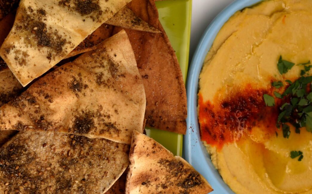 Baked chips with roasted garlic hummus