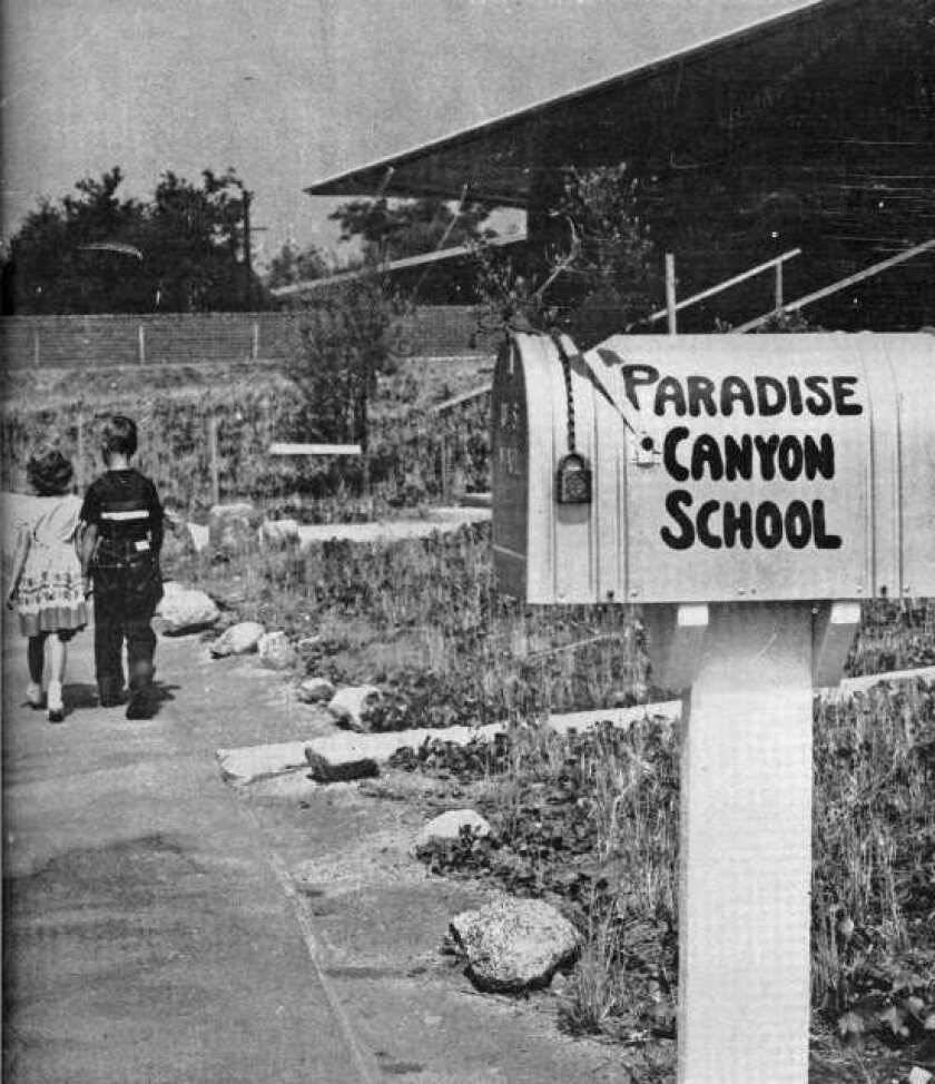 Siblings Judy and Jerry Brawley walk along the driveway at Paradise Canyon Elementary School in September 1952 for a back-to-school Valley Sun cover photo.
