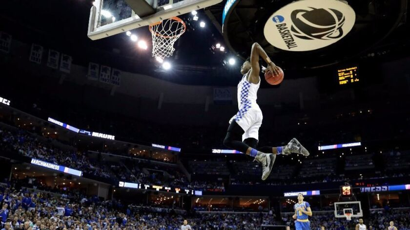 Kentucky's De'Aaron Fox rises up for a dunk during the second half of an NCAA tournament game agains