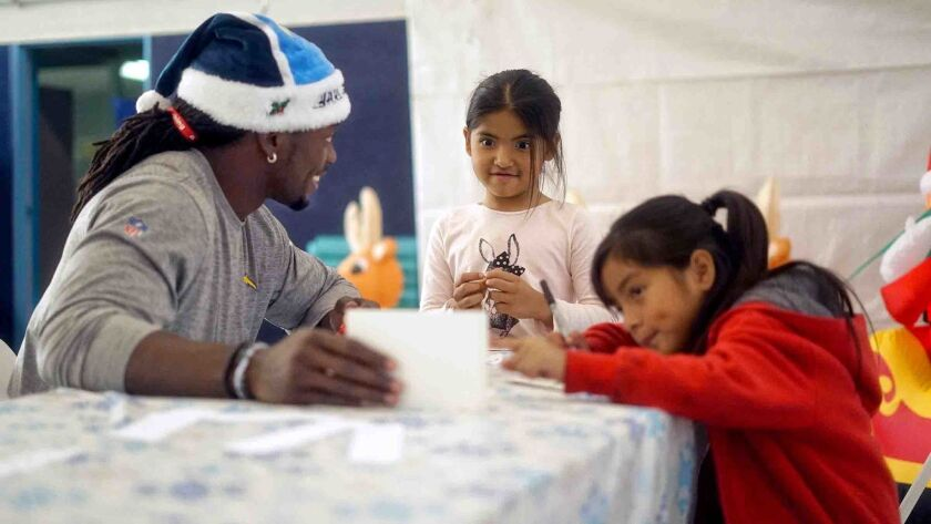 Melvin Gordon makes crafts with kids at an event for his foundation. (Photo by Will Houlihan)