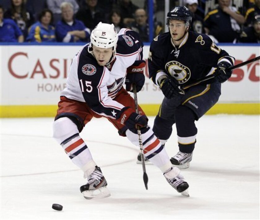Columbus Blue Jackets' Derek Dorsett (15) handles the puck as St. Louis Blues' Vladimir Sobotka, of the Czech Republic, watches during the first period of an NHL hockey game, Saturday, March 31, 2012, in St. Louis. (AP Photo/Jeff Roberson)