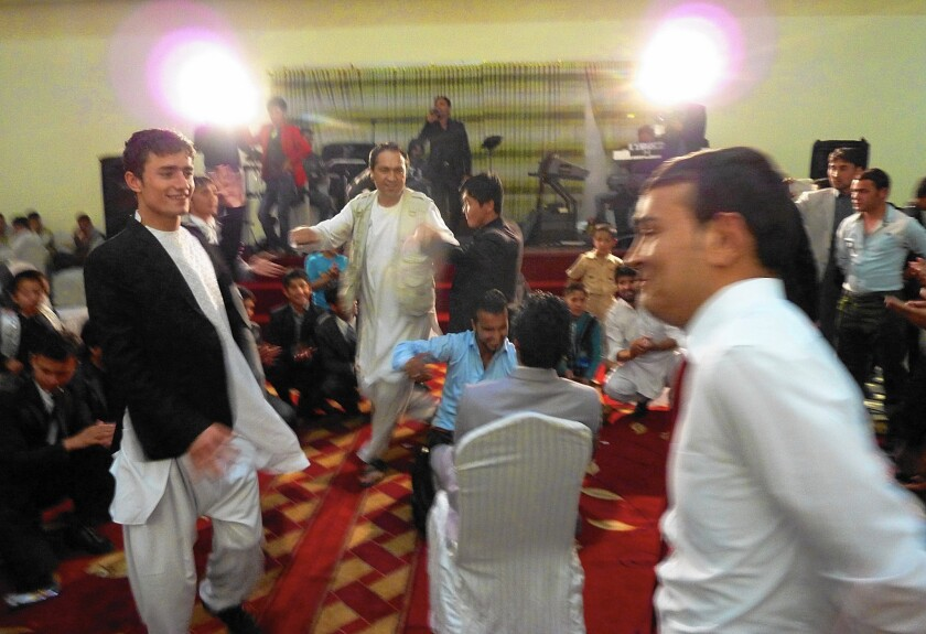 Afghan weddings, such as this one in Kabul, often take place in lavish halls. A law passed in March aims to rein in what is traditionally a very costly celebration.