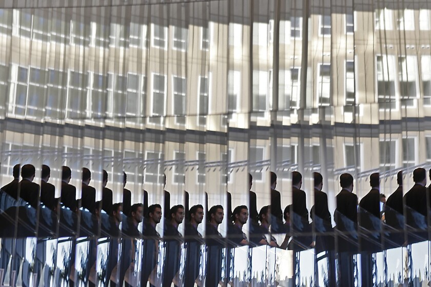 Two staff members are reflected dozens of times as they ascend a mirror-lined spiral staircase in the lobby of the W Hotel in Hollywood on Jan. 26, 2010. The hotel is LEED-certified by the U.S. Green Building Council.