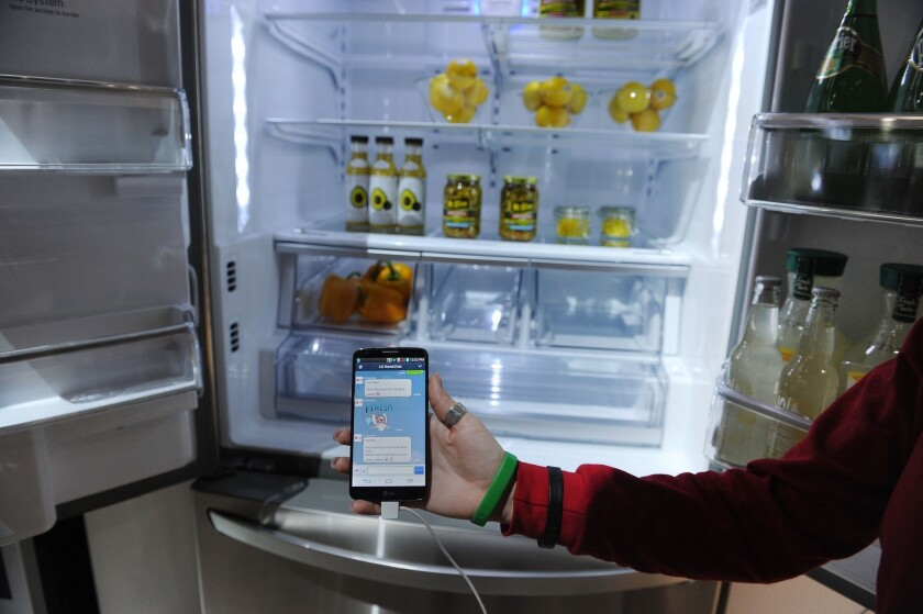 """Hackers used a refrigerator in a recent cyber attack. Shown here is a """"smart"""" fridge that connects to the Internet, displayed at International CES, a consumer electronics show in Las Vegas."""
