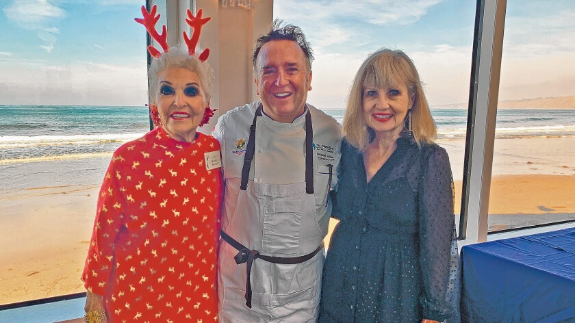 Marilyn Barrett, The Marine Room executive chef Bernard Guillas and Linda Jenerette attend the Village Garden Club of La Jolla's Holiday Luncheon, Dec. 12, 2019 at The Marine Room in La Jolla.