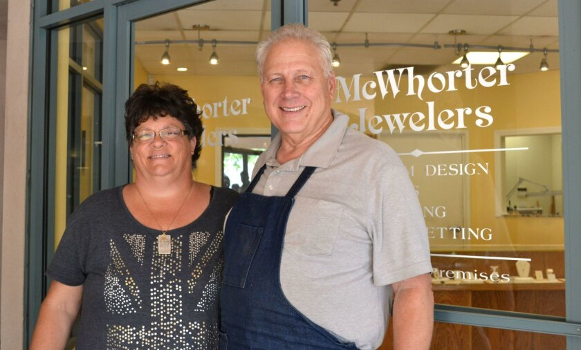 Mary Ellen and Arthur McWhorter stand outside their jewelry store at 1140 Main St. They are closing the retail store but will sell custom jewelry online and offer jewelry repairs and restorations.