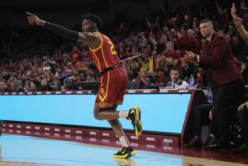 USC guard Jonah Mathews reacts after hitting one of his five three-pointers including the game-winner in the second half of a game against UCLA on March 7 at Galen Center.