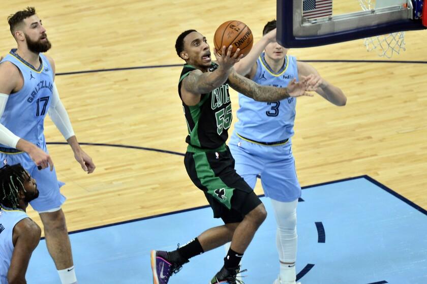 Boston Celtics guard Jeff Teague (55) shoots against Memphis Grizzlies guard Grayson Allen (3) in the first half of an NBA basketball game Monday, March 22, 2021, in Memphis, Tenn. (AP Photo/Brandon Dill)