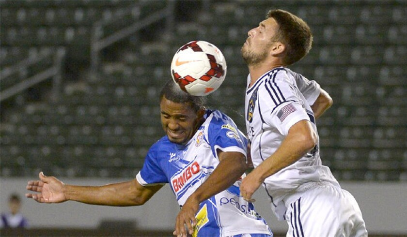 Isidro Metapan's Hector Ramos and the Galaxy's Tommy Meyer fight for the header during L.A.'s 1-0 victory in the CONCACAF Champions League tournament match.