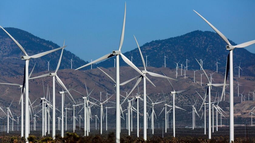 Key to 100% renewable energy? Wind farms such as this installation in the Tehachapi Pass are at the heart of a legal dispute among climate change experts.
