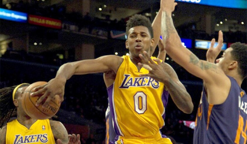 Nick Young passes behind his back to Jordan Hill during Tuesday's loss to the Phoenix Suns, 114-108, at Staples Center.