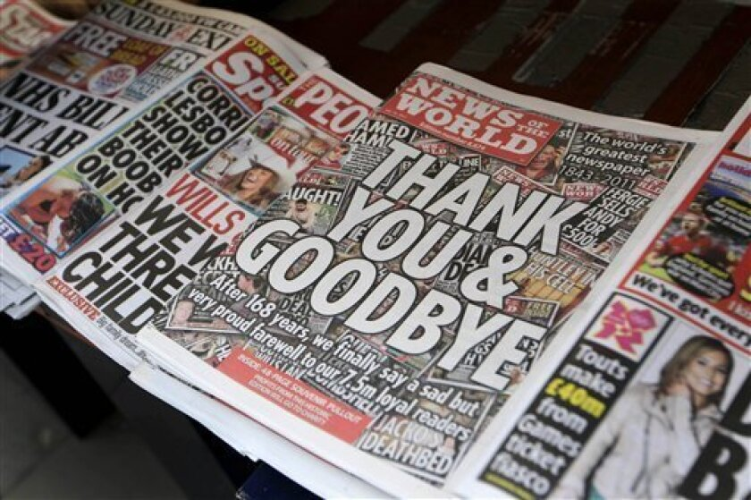 """A stack of last edition of News of the World is placed at a newspaper vendor in central London, Sunday, July 10, 2011. Britain's best-selling Sunday tabloid signed off with a simple front page message, """"THANK YOU & GOODBYE"""", leaving the media establishment here reeling from the expanding phone-hacking scandal that brought down the muckraking newspaper after 168 years. (AP Photo/Sang Tan)"""