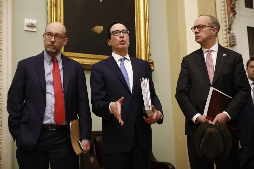 Treasury Secretary Steven T. Mnuchin, center, is leading the White House negotiating team on the stimulus.